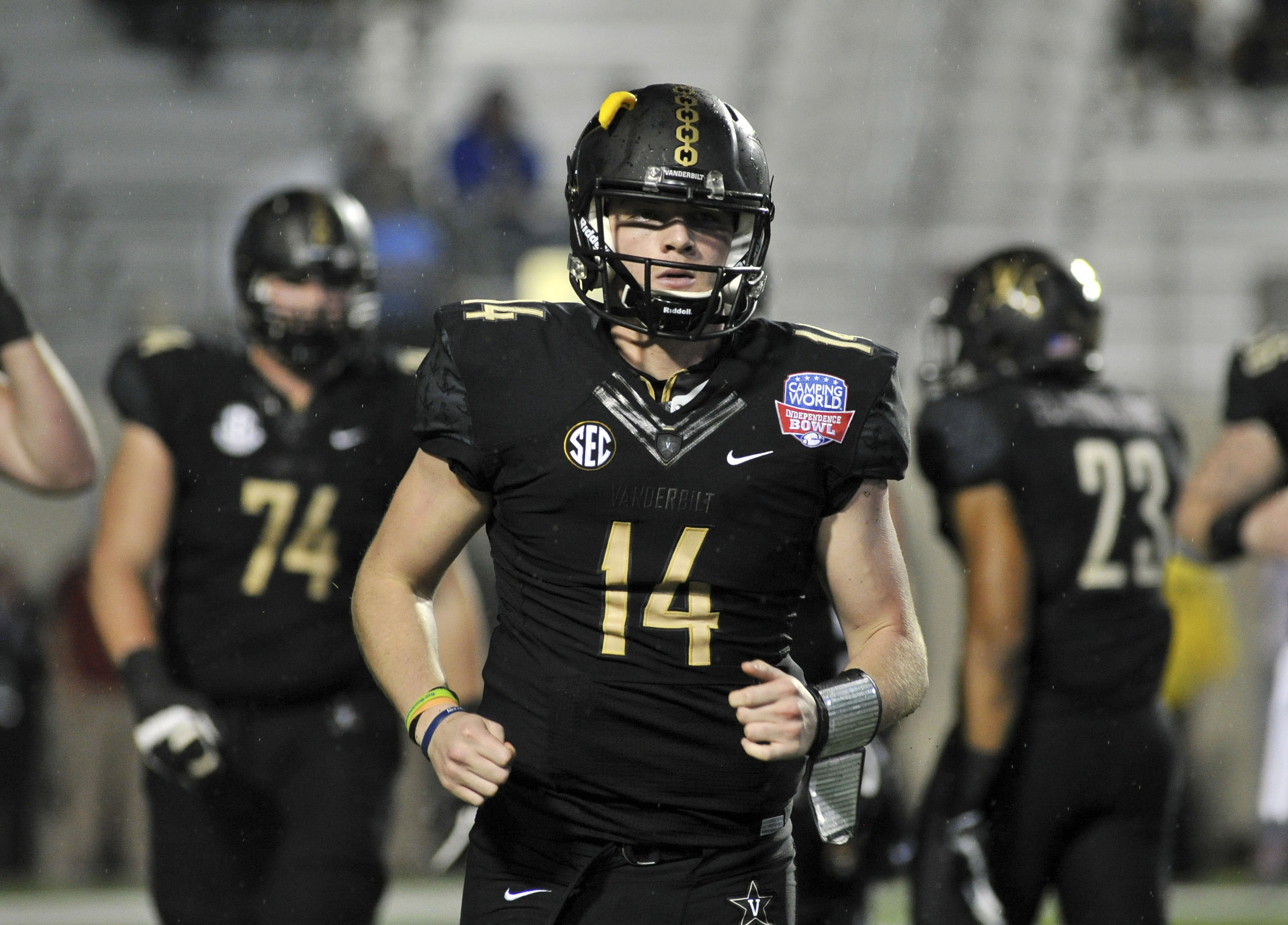 dd4eb776fdc Dec 26, 2016; Shreveport, LA, USA; Vanderbilt Commodores quarterback Kyle  Shurmur (14) comes off the field during the second half against the North  Carolina ...